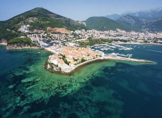 Aerial photo of the Old Town of Budva on the coast of the Adriatic Sea, Montenegro, Europe. Photo was taken from the helicopter. Wide-angle lens.
